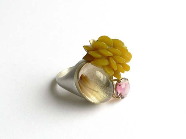 """<span class=""""prodinfo"""">Rings for planet earth —'botany 1' — ring 2008<br /> <em>Total height</em> 31 mm<br /> <em>Material</em> 14ct gold, silver, tourmaline, quartz, resin</span><a href=""""mailto:jantje@jantjefleischhut.com?subject=JANTJE%20FLEISCHHUT%20/%20Online%20Collection&body="""" class=""""buy"""" title=""""You need a Email-Client to order products.""""></a>"""
