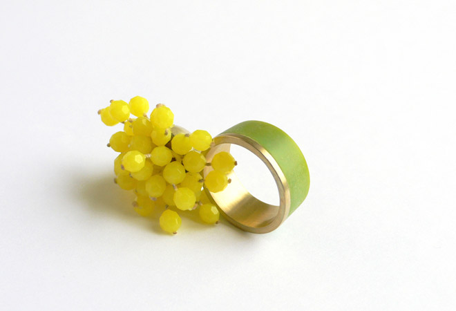 """<span class=""""prodinfo"""">Rings for planet earth — 'botany 4' — ring 2008<br /> <em>Total height</em> 28 mm<br /> <em>Material</em> 14ct gold, plastics</span><a href=""""mailto:jantje@jantjefleischhut.com?subject=JANTJE%20FLEISCHHUT%20/%20Online%20Collection&body="""" class=""""buy"""" title=""""You need a Email-Client to order products.""""></a>"""