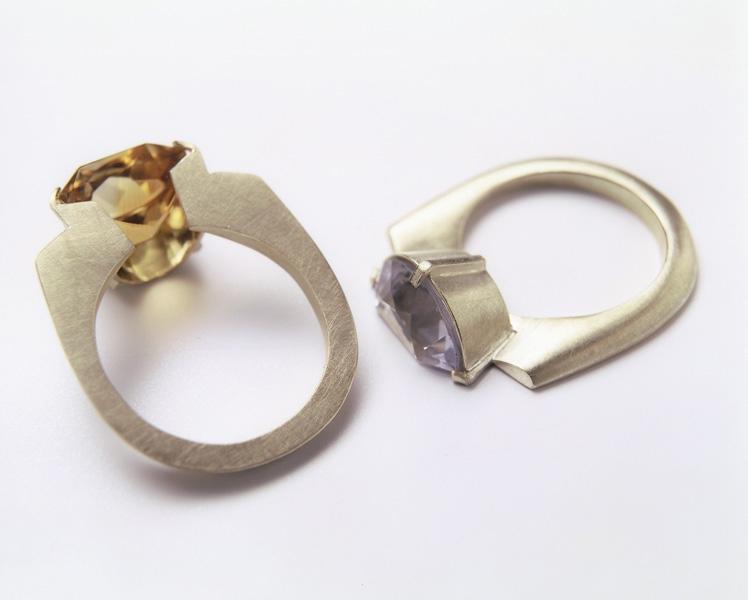 "<span class=""prodinfo"">'0,5ring'<br /> <em>Height </em> +/- 30 mm <em>stones width</em> +/- 100  x 120 mm<br /> <em>Material</em> 14carat, precious stones cut through half<br /> <em>Price</em> € 2500.–</span><a href=""mailto:jantje@jantjefleischhut.com?subject=JANTJE%20FLEISCHHUT%20/%20Online%20Collection&body="" class=""buy"" title=""You need a Email-Client to order products.""></a>"