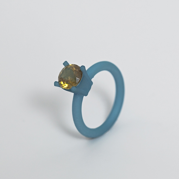 """<span class=""""prodinfo"""">'REALPLASTIC' — rings, blue, green<br /> <em>Total hight </em> 25–32 mm<br /> <em>Material</em> 3Dprint, hand coloured, various precious stones<br /> <em><strong>€ 210,– sold out</strong></em></span><a href=""""mailto:jantje@jantjefleischhut.com?subject=JANTJE%20FLEISCHHUT%20/%20Online%20Collection&body=The product of your dreams...%0A----------------------------------%0A'REALPLASTIC' — RING Price € 210.– %0A----------------------------------%0APlease leave your favorite selection/colour:%0A%0AName: %0A%0AAdress: %0A%0ACity: %0A%0A%0AWe will give you a message for the procedure.%0AJANTJE FLEISCHHUT jewellery is love%0A----------------------------------%0AAll prices are inclusive VAT and exclusive delivery charges.%0AAll prices announced in the Online Gallery handled carefully however without engagement.%0AThe exact delivery date cannot be specified of articles sent abroad.%0ADelivery will take place on full payment."""" class=""""buy"""" title=""""You need a Email-Client to order products."""">Buy this</a>"""
