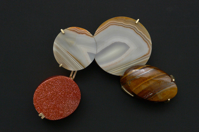 "<span class=""prodinfo"">'the other one' — brooch 2009<br /> <em>Length</em> 95×80 mm<br /> <em>Material</em> 14ct gold, agate, tiger eye, synthetic stones</span><a href=""mailto:jantje@jantjefleischhut.com?subject=JANTJE%20FLEISCHHUT%20/%20Online%20Collection&body="" class=""buy"" title=""You need a Email-Client to order products.""></a>"
